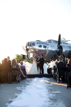 Arizona Wedding at the Commemorative Air Force Museum in Mesa. This links to a blog with a ton of photos of the wedding, truly amazing vintage wedding.   Aviation theme, grey and purple wedding, elegant