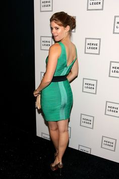 Kate Mara in a green body con dress and high heels
