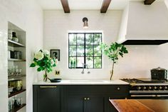 Shelving niche, black lowers, contemporary hood black white and brass, black cabinets, black kitchens, brass knob, hood, gray paint, black lower cabinets, white kitchens, kitchen cabinets