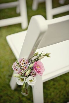 aisle markers on white chairs