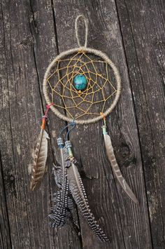 Dream Catcher With Turquoise Stone and Feathers Native American. $35.00, via Etsy.