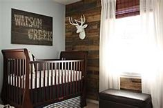 love the accent wall made out of pallet wood and the DIY sign above the crib.LOVE LOOVE LOVE. Except for our baby boy name, it would say Dawson Creek and well.. you just can't do that.