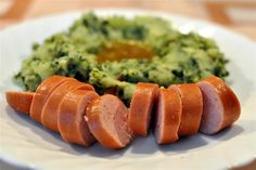 Dutch stamppot boerenkool met rookworst ('mash pot', potatoes mashed with kale and served with smoked sausage)