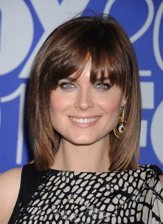 Emily Deschanels shoulder length straight layered hairstyle with bangs | Your Hairstyle Solutions
