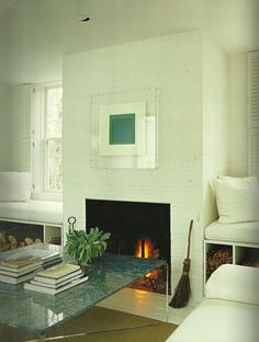 Seating at windows on either side of the fireplace, nice idea.