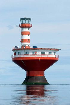 (Haut-fond Prince Light)  One of the most dangerous shoals in the St. Lawrence River is found near Tadoussac, Quebec, off mouth of Saguenay River.  The cylindrical tower with red and white horizontal stripes, on top of circular dwelling on caisson, resembles a child's top. Built in 1964, the light replaces the Prince Shoal Lightship station, that had been established in 1902. The lighthouse warns passing vessels of the undersea hazard in the area. The tapered base helps it resist the 20-foot ...