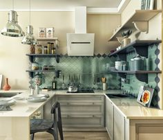 The kitchen is small but spectacular with a reflective tiled backsplash and another breakfast bar.