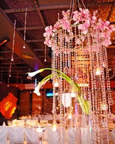Club Bat Mitzvah & Party Theme Ideas - Hanging Crystal Chandelier Centerpieces with Calla Lily {Lasting Memories Photography} - www.mazelmoments.com/blog/19023/lounge-club-nightclub-theme-ideas-bar-bat-mitzvah-party-sweet-16/