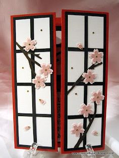 delightful gate card simulating a screen with cherry blossoms on branches...
