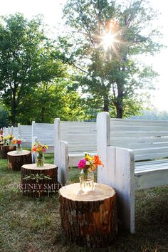 Love the white pews and tree stumps