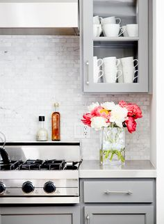 gray cabinetry and backsplash