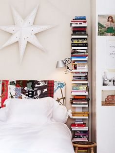 Vertical bookshelf!  I would love this next to my bed.