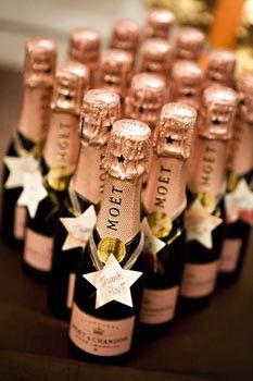 Mini-champagne bottles as favors.