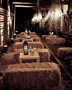 Bales of hay and burlap accents created a rustic-chic lounge scene for a barn wedding.