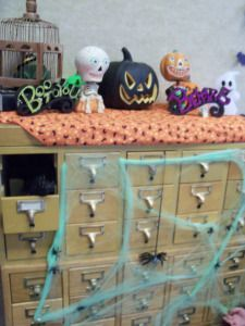 """Pumpkin Party"" in a library conference room -- ""There happened to be an old skool card catalog in there, so we decided to make it spooky."""