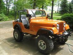 Bright orange Jeep CJ-5