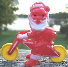 Vintage Christmas Collectible ~ Santa Claus on Bicycle Candy Container, Circa 1950's.