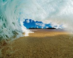 Wave Hitting The Sand