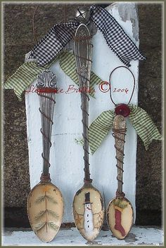 Christmas Spoon Ornaments  supplies:  *spoons  *kilz primer  *fine grit sandpaper  *paints of your choice for your designs  *crystal glitter  *water based sealer  *rusty wire  ***OPTIONAL ~NO PAINT SUPPY: Christmas Rub-on transfers  tutorial at this website: http://charsethman.blogspot.com/2008/11/tuesdays-tutorial-christmas-spoon.html