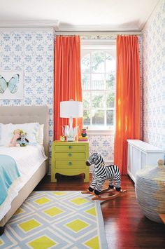 Colorful childrens bedroom with orange curtains #LandofNod child room, curtains for a blue room, girl room, room colors, childrens bedroom, children's bedroom, children bedroom, kid rooms, bright colors