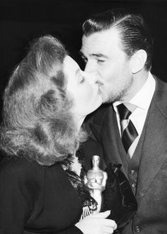 Walter Pidgeon and Greer Garson share a kiss after Garson's Oscar win 1942. a kiss, walter pidgeon, oscar win, 1greer garson, kiss smooch, actress, oscarsth envelop, kisses