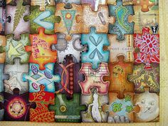 Altered puzzle  This would make such a neat swap with friends. Everyone gets the same puzzle (kids size would be easiest) and they make pieces to send to their friends. You all end up with the whole puzzle and the pieces make a very cool design!