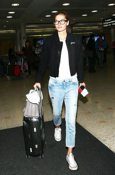 The Victoria's Secret angel went for a tomboy look in converse, black-rimmed glasses, and boyfriend jeans // Jessica Hart