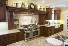 I Love the cabinets and how you are able to decorate above the stove.