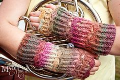Ravelry: Mad Wrist Wraps #1-Cables and Shells pattern by Charissa Ragsdale