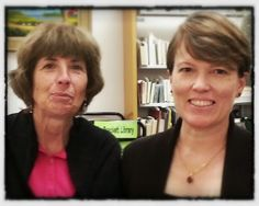 Susan and Rebecca at the front desk invite you to stay a while in the Library - the Community Living Room!