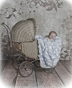 Newborn boy in vintage baby buggy - not a huge fan of the image, but love their use of the buggy!