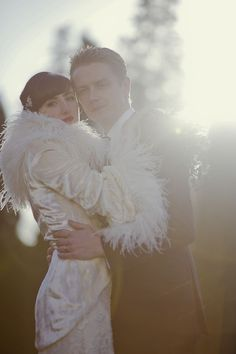 Exquisite 1930's inspired day coat worn by this Winter bride.  Crushed velvet, feathers and gorgeous silk lining...