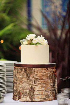 Sweet and Simple: 25 Wedding Cakes For the Minimalist Couple: Just a hint of bead-like texture, lace, and leaves make this one divine dessert.