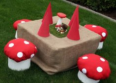 Gnome table and toadstools so cute.