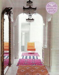 rugs down a narrow hallway