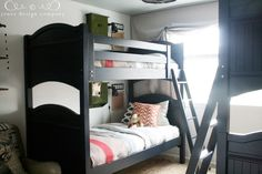 Love the bunks with the old school lockers and cork boards per bunk.