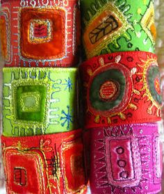 from Dog-Daisy Chains: lovely cuffs make from bits of silk