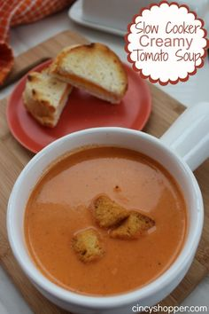 Slow Cooker Creamy Tomato Soup. Perfect fall soup paired with a grilled cheese sandwich.  Now, all we need is fall weather in Houston :)