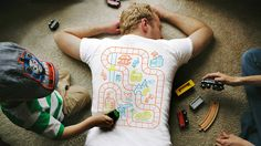 Genius t-shirt playmat includes a built-in massage for Mom or Dad