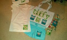 appliqued tote bag, cut the fabric out with my cricut, used heavy duty fusing and they came out great!