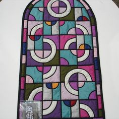 Drunkards Path as a stained glass patchwork piece- love the idea