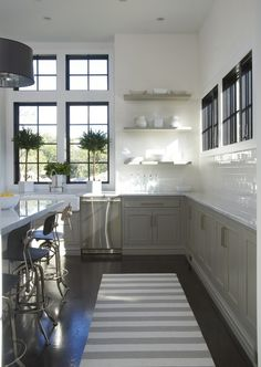 Beautiful white kitchen with green/grey cabinets...airy, clean & cool