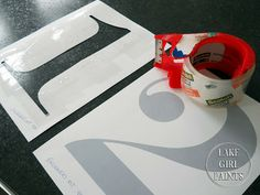 "Lake Girl Paints: How to Stencil Large Graphic Numbers on Fabric... make your own stencil by printing out (on card stock) and ""laminating"" both sides with PACKING TAPE. cut out the places you want the paint to go through."