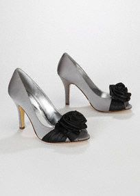 """Unique and chic, this colorblock peep toe will spice up any ensemble!  Classicpeep toe silhouette gets a flirty and fun touch with ribbon rose accent.  Colorblock design adds just the right amount of contrast.  Available in Apple with Black Rose, Mercury with BlackRose and Ivory with Champagne Rose.  3 3/4"""" heel, leather insole. Imported."""