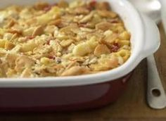 Cooked macaroni is combined with butter & cheddar cheese in a baking dish, and topped with a saucy mixture of soup, milk, mayo and pimiento.