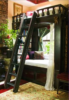 Love everything about this..the loft...the window seat..the bookshelves...the plant..