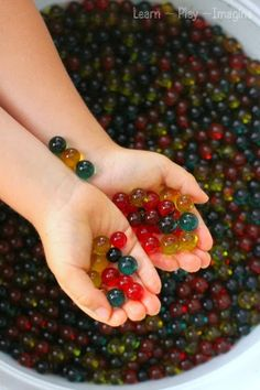 How to add color and scent to water beads for falls sensory play:  golden delicious yellow, apple cinnamon green, and candy apply red