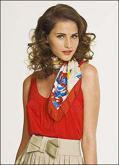 The silk scarf tied around the neck. Classic.