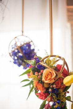 floral arrangements hanging in metal spheres, photo by Koli Nichols Photography http://ruffledblog.com/the-notwedding-birmingham #weddingideas #flowers #hangingcenterpieces