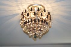 chandelier made out of nail polish bottles. perfect for me!